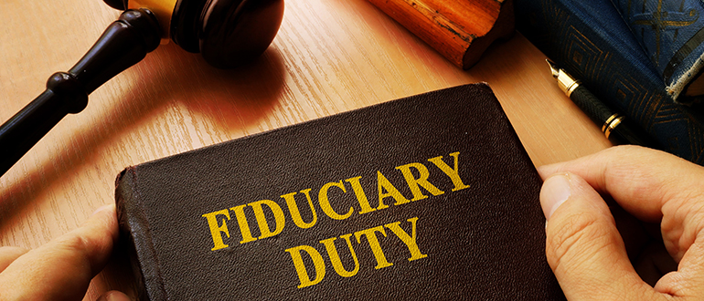 Hands holding Fiduciary duty in an court.
